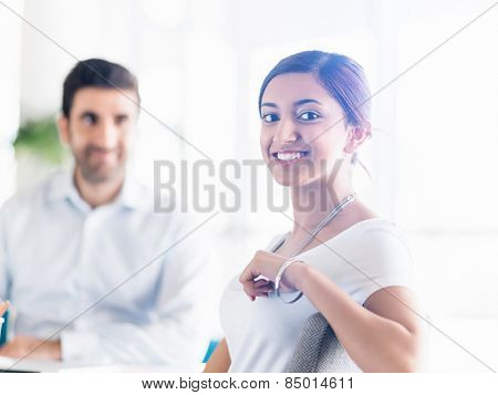Two young happy collegues in offfice