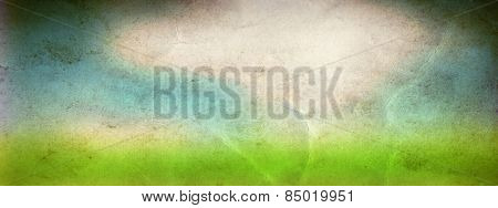 Concept or conceptual green fresh summer or spring grass field over a blue sky background on a vintage old paper, metaphor to nature, season, rural, outdoor, environment, pasture, growth conservation