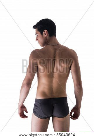 Back Of Handsome Young Man In Underwear Isolated On White