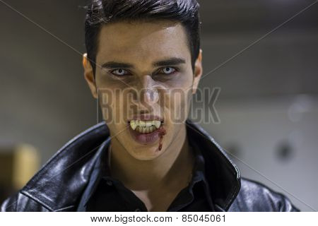 Young Vampire Man Face With Blood On His Mouth