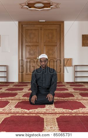 African Muslim Praying In Mosque