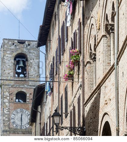 Colle di Val d'Elsa (Siena Tuscany Italy) historic city. Old houses with potted plants and flowers poster