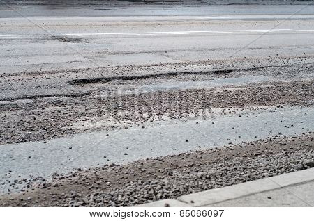 Large Deep Pothole