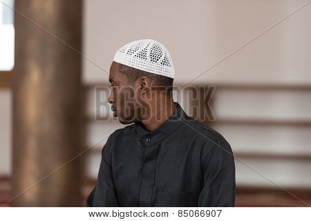 African Muslim Man Praying At Mosque