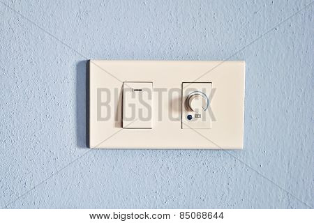 Single Electrical Power And Dimmer Switched On, Blue Background.