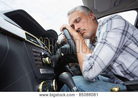 Drunk man slumped on steering wheel in his car poster