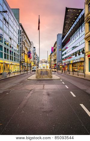 BERLIN, GERMANY - SEPTEMBER 20, 2013: Checkpoint Charlie. The crossing point between East and west Berlin became a symbol of the Cold War.