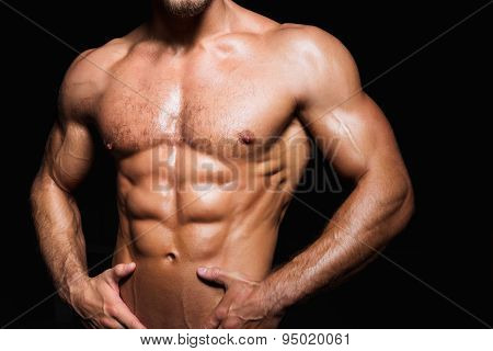 Muscular and sexy torso of young sporty man with perfect abs close up poster
