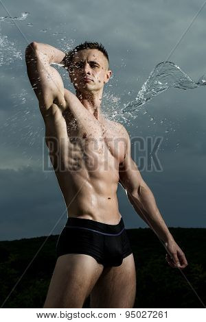 Sexy Bodybuilder In Water Splashes