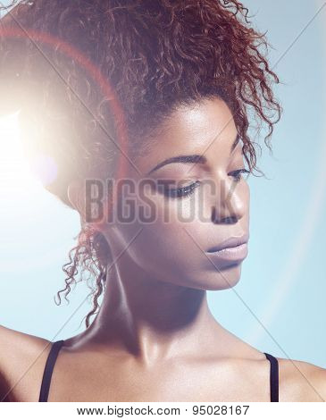 Portrait Of Black Woman Watching Aside With A Sun Flair