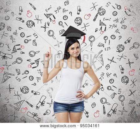 Brunette Lady Is Presents A Necessity Of Higher Education. Graduation Hat Above Her Head. Educationa