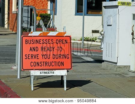 MONTEREY, CA - NOVEMBER 14:  Business Open During Construction Sign  2012