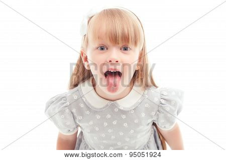 Upbeat girl showing tongue