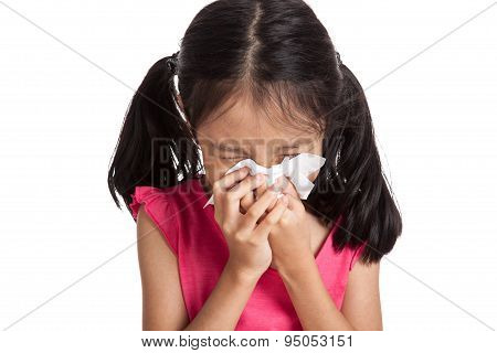 Little asian girl sneeze with napkin paper isolated on white background poster