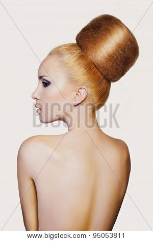 elegant woman with creative hair style. Fashion model with creative huge bun hairstyle with big chig