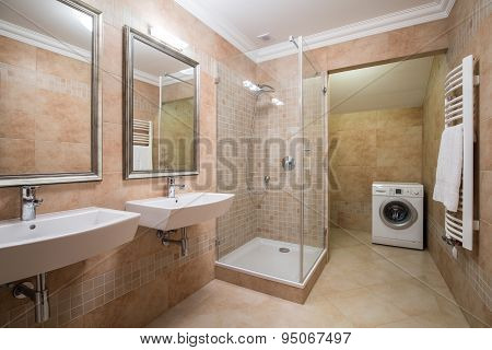 Washing Machine In Beige Bathroom