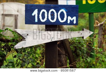 Rustic Wooden Road Direction Sign
