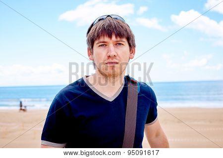 Stylish man on the beach