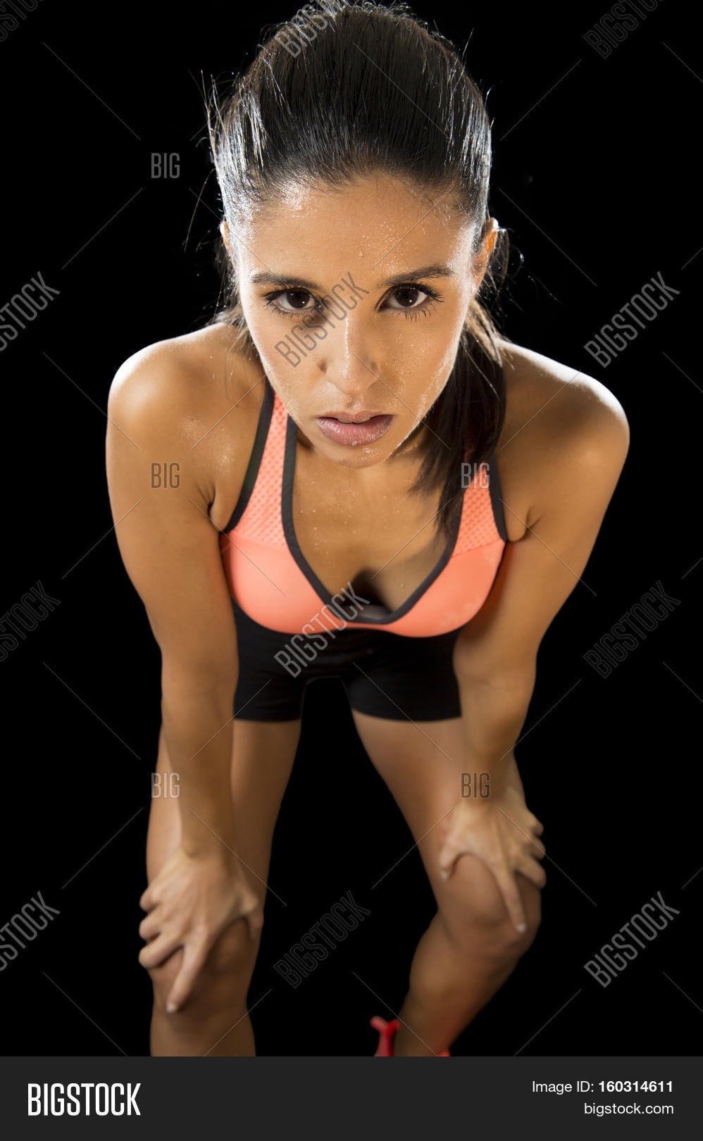 2ced9214f6fa3 young attractive sexy latin sport woman posing in fierce and badass face  expression with fit slim