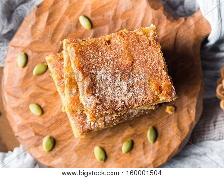 Apple And Pumpkin Spiced Blondies On Wooden Board