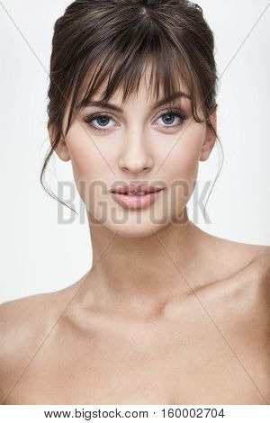 strong facial expression and emotion concept - young woman portrait with sarcastic unsure grimace on her face