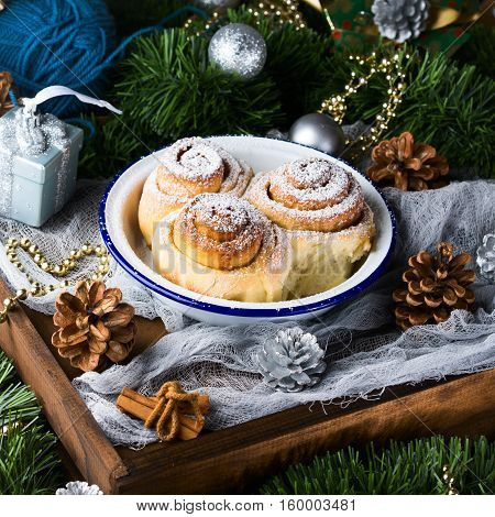 Cinnamon Roll Buns With Christmas Decorations. Square