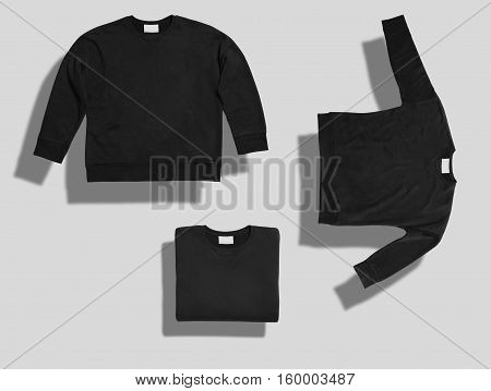 Unlabeled black short sweatshirt shot in three different shapes on white background