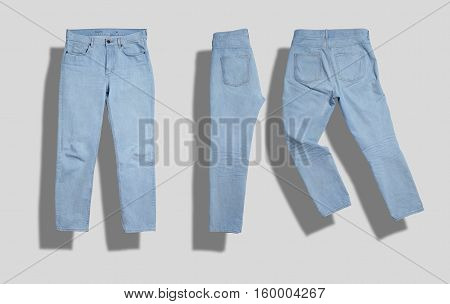 Classic light blue jeans shot as a set from the front, back and folded in half on white background