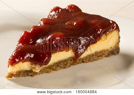 Cheesecake With Brazilian Goiabada Jam Of Guava On Plate On Table