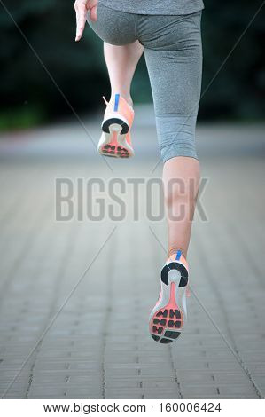 A picture of a woman's legs running outdoors