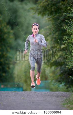 young woman running on road. woman fitness jog workout wellness concept.