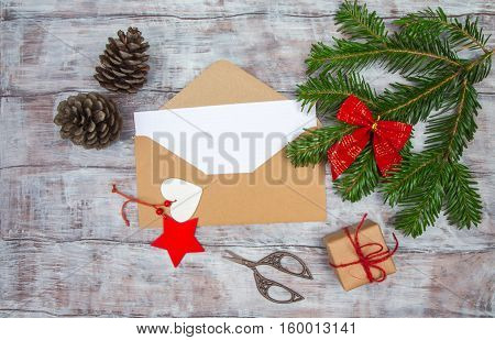 Envelope With Blank Sheet Of Paper On Christmas Background