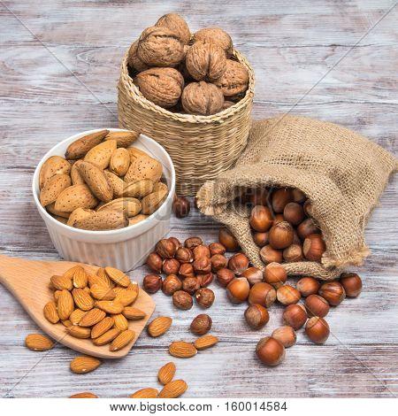 Assorted Nuts: Hazelnut, Almonds, Walnuts On Wooden Background