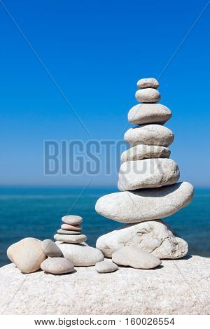large pyramid of white stones against the sea Concept of balance and harmony.