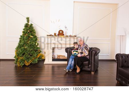 Grandchild and grandmother together near the christmas tree