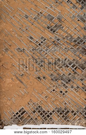 Old Broken plaster on lath.. Old Broken Plastered White Yellow Wall Or Celling With Wooden Lathing Under Stucco Grungy Vintage Frame Square Background Texture Wallpaper Backdrop With Copy Space.