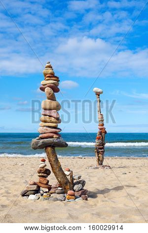 Two great towers of colored stones against the sea Balance and poise stones.