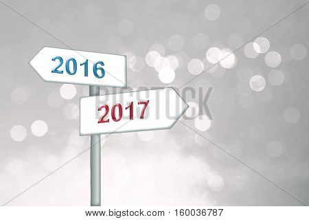 Silver Winter Background With Soft Circles, Signpost With Change 2016 To 2017