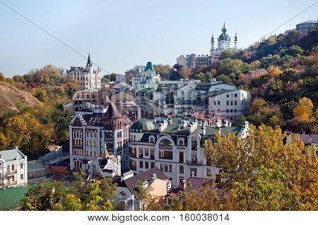 Kiev city. Old houses on the Vozdvizhenska street and St. Andrew's Church against the blue sky. Capital of Ukraine - Kyiv.