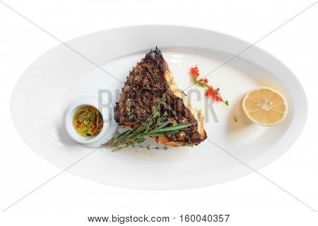 Grilled flounder on plate, isolated on white background