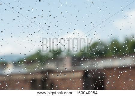 Raindrops Od Window Glass With Industrial Buildings And Chimneys As Background