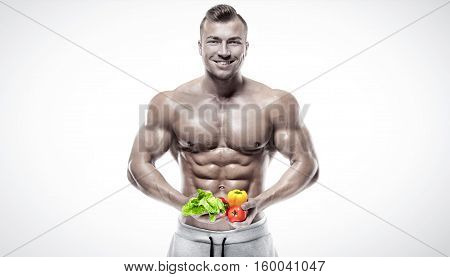 Shaped And Healthy Bodybuilder Holding A Fresh Vegetables, Flying Vegetables