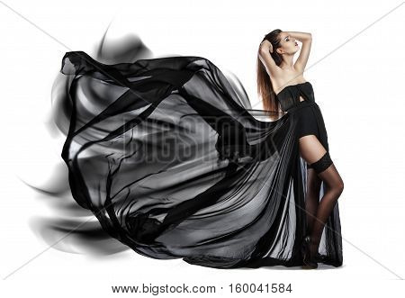 Beautiful Young Girl In Flying Black Dress. Flowing Fabric