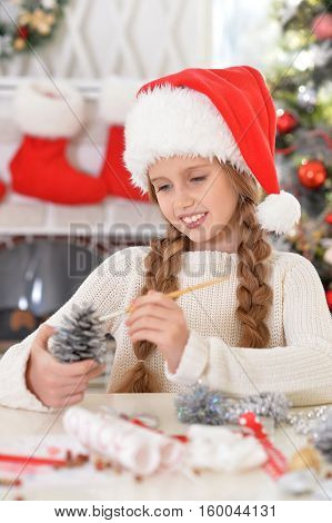 Portrait of happy preteen girl preparing for Christmas at home