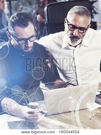 Concept of digital screen, virtual connection icon, diagram, graph interfaces.Young bearded man working together with colleague in new startup project.Business people teamwork.Vertical, blurred