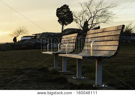 Unoccupied benches on winter evening at Fort Phoenix in Fairhaven Massachusetts