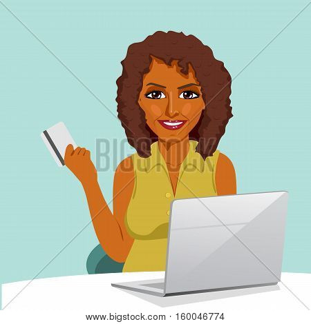 african american woman with laptop shopping on line holding a credit card