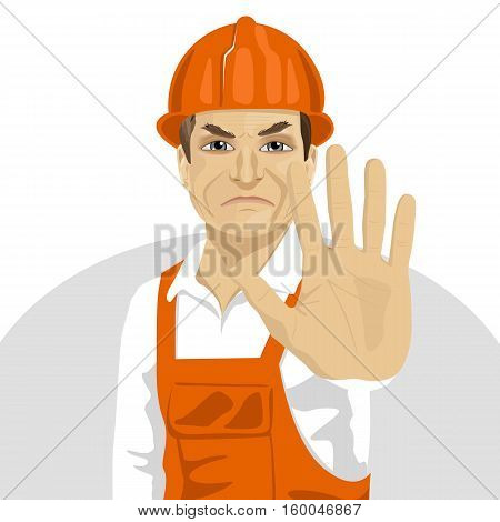 mature road worker in a hard hat showing stop gesture