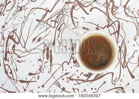 cup of fresh espresso art painted background, view from above