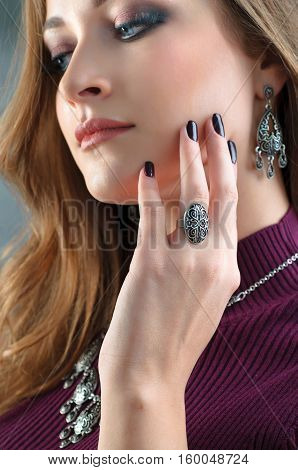 Closeup of a model wearing jewelry. Most focus is on hand.Close up female model wearing ethnic jewelry
